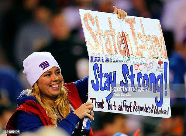 A fan of the New York Giants holds up a sign thanking first responders in the Staten Island borough of New York City that was ravaged during...