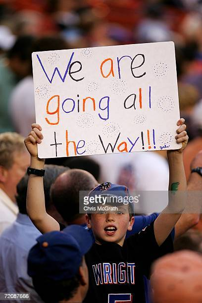 A fan of the New York Mets holds up a sign reading We Are Going All The Way during a game against the Los Angeles Dodgers during game one of the...