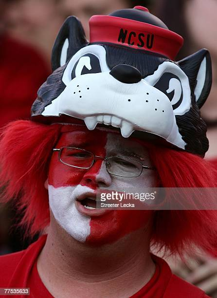 Fan of the North Carolina State Wolfpack watches their game against the Virginia Cavaliers at Carter-Finley Stadium October 27, 2007 in Raleigh,...
