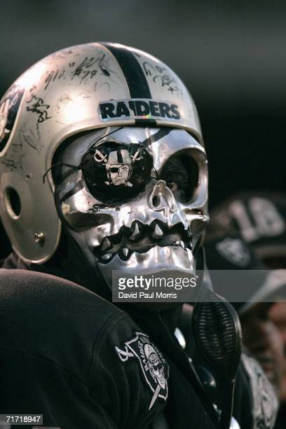 A fan of the Oakland Raiders watches his team as the Oakland Raiders host the Detroit Lions at McAfee Stadium on August 25 2006 in Oakland California