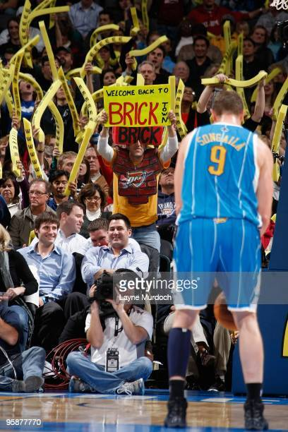 A fan of the Oklahoma City Thunder holds up a sign as Darius Songaila of the New Orleans Hornets shoots a free throw during the game on January 6...