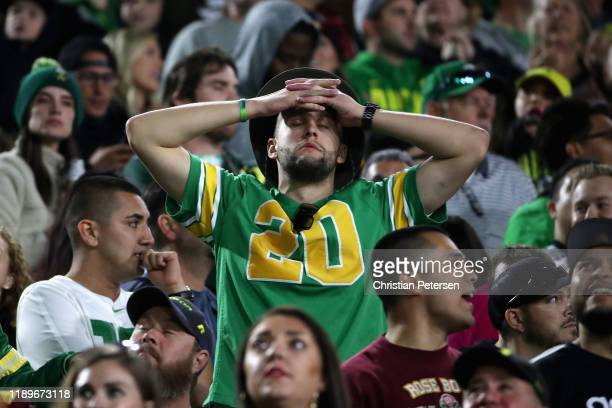 Fan of the Oregon Ducks reacts during the second half of the NCAAF game against the Arizona State Sun Devils at Sun Devil Stadium on November 23,...
