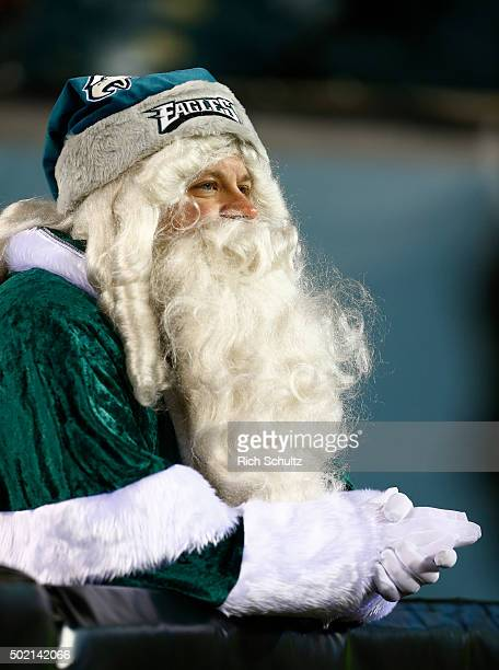 A fan of the Philadelphia Eagles dressed as santa watches during the fourth quarter in a football game against the Arizona Cardinals at Lincoln...