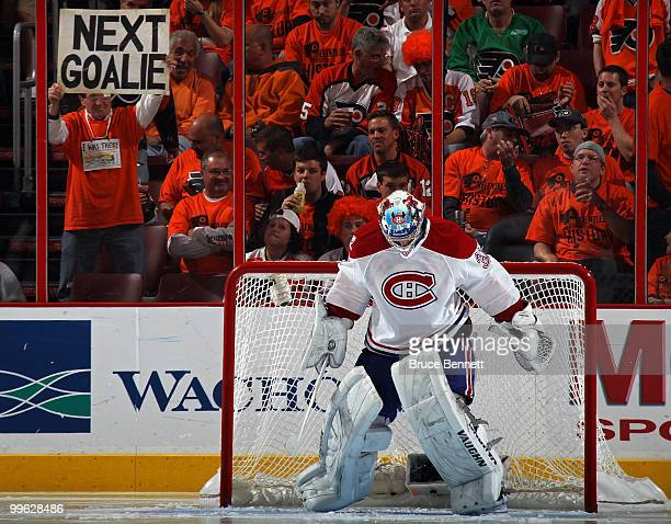 A fan of the Philadelphia Flyers holds up a sign reading 'Next Goalie' behind goalie Carey Price of the Montreal Canadiens in Game 1 of the Eastern...