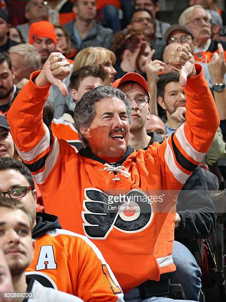 A fan of the Philadelphia Flyers reacts following a call on the ice during their game against the Pittsburgh Penguins on October 29 2016 at the Wells...