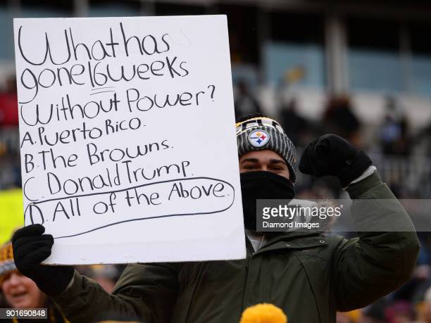 A fan of the Pittsburgh Steelers holds up a sign in the fourth quarter of a game on December 31 2017 against the Cleveland Browns at Heinz Field in...