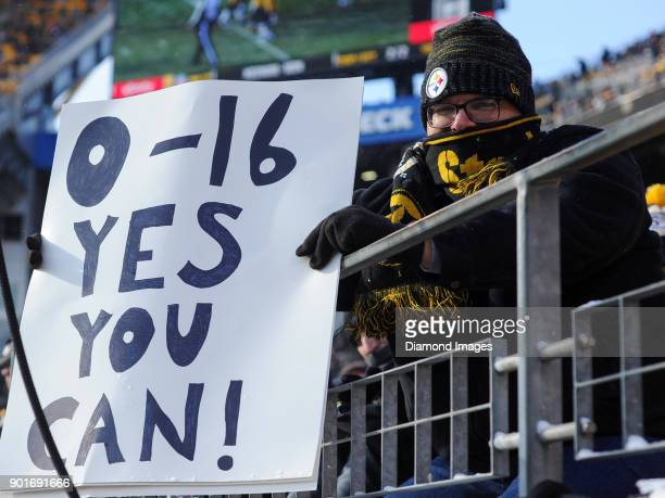 A fan of the Pittsburgh Steelers holds up a sign in the second quarter of a game on December 31 2017 against the Cleveland Browns at Heinz Field in...