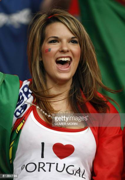 A fan of the Portuguese national football team cheers the players during training session at Neuchatel on June 3 ahead of the Euro 2008 Football...