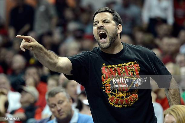 A fan of the San Diego State Aztecs yells at a referee during the second half of a semifinal game of the Reese's Mountain West Conference Basketball...
