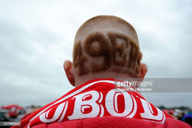 A fan of the San Francisco 49ers shows a detail of the 49ers logo shaved into the back of his head in the parking lot prior to the 49ers playing...