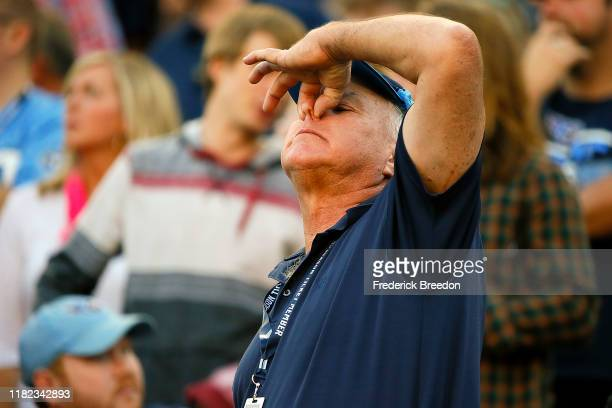 Fan of the Tennessee Titans holds his nose after a call against the Los Angeles Chargers was reversed during the second half at Nissan Stadium on...