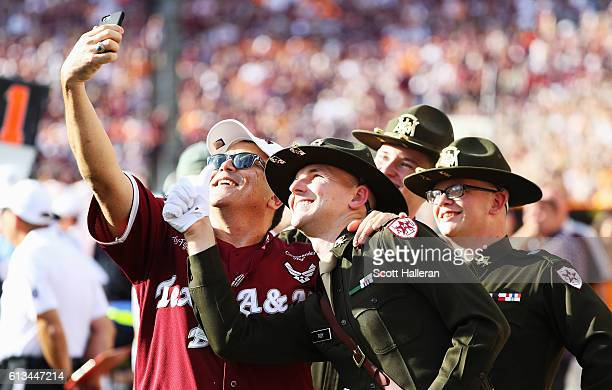 A fan of the Texas AM Aggie fan takes a selfie with corp cadets in the second half of their game against the Tennessee Volunteers at Kyle Field on...