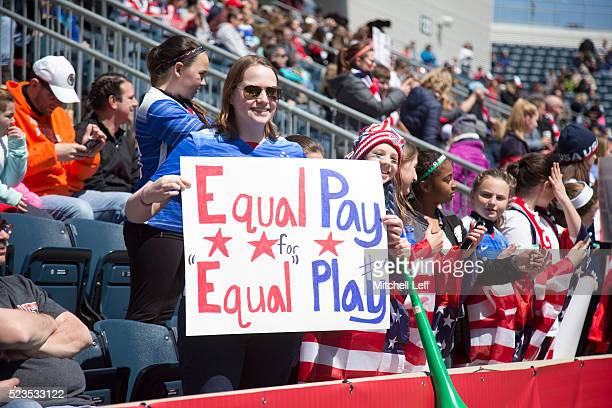 A fan of the United States holds a sign that reads Equal pay for equal play during the game against Colombia at Talen Energy Stadium on April 10 2016...