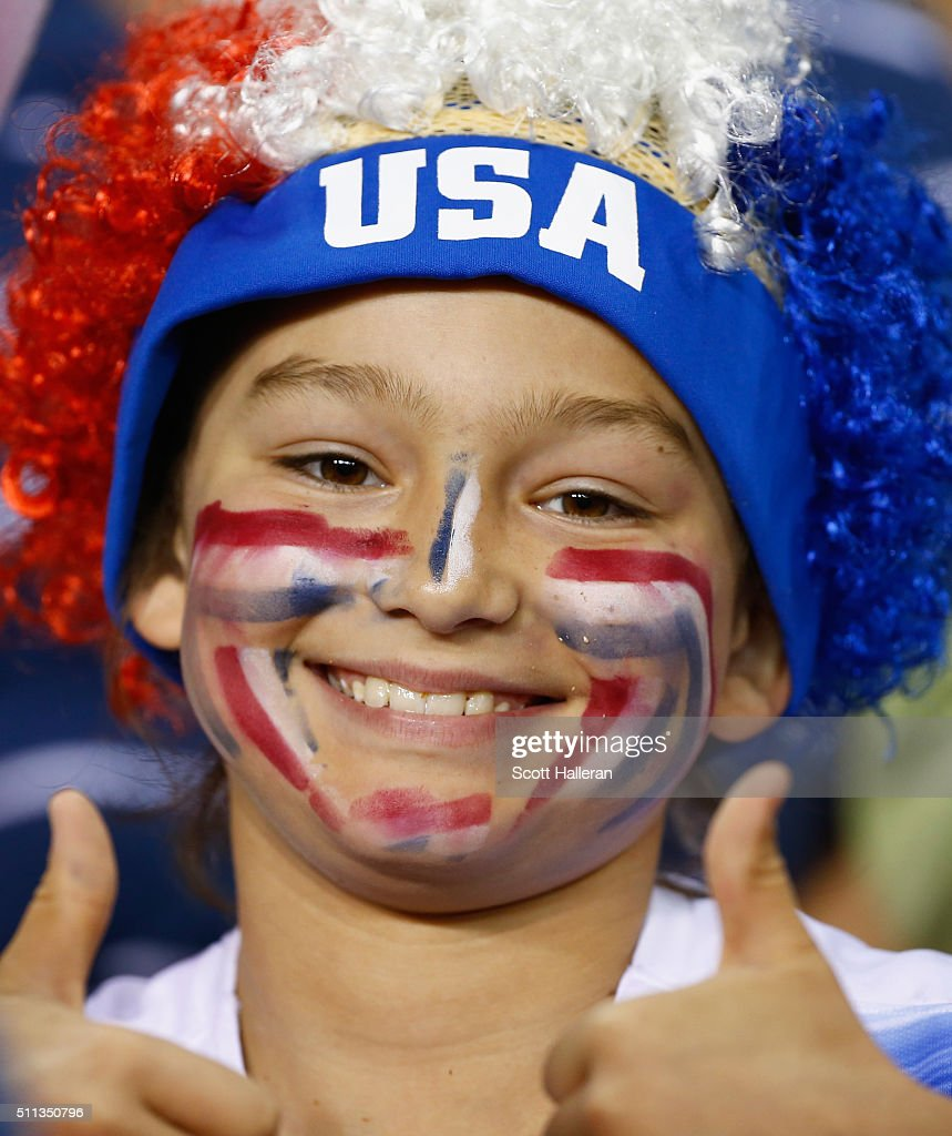 A fan of the United States waits for the start of the game against Trinidad and Tobago during their Semifinal of the 2016 CONCACAF Women's Olympic Qualifying at BBVA Compass Stadium on February 19, 2016 in Houston, Texas.