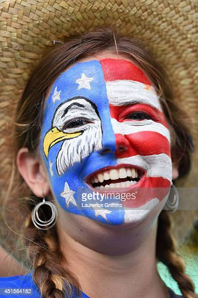A fan of the United States with a painted face enjoys the atmosphere prior to the 2014 FIFA World Cup Brazil Round of 16 match between Belgium and...