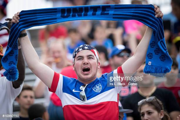 Fan of the U.S. Men's National Team holds up a scarf that says UNITE during the International Friendly Match between U.S, Men's National Team and...