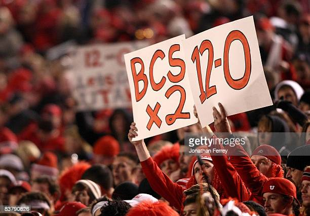 Fan of the Utah Utes holds a a sign after defeating the BYU Cougars 48-24 to complete a pefect 12-0 season at Rice-Eccles Stadium on November 22,...