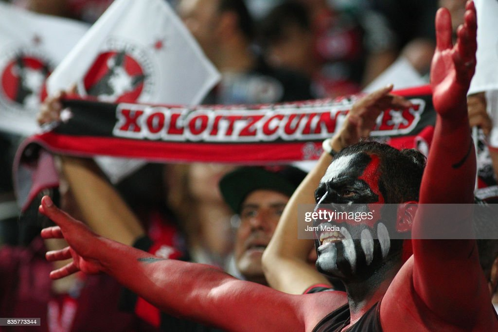 A fan of Tijuana cheers for his team during the fifth round match between Tijuana and Santos Laguna as part of the Torneo Apertura 2017 Liga MX at Caliente Stadium on August 18, 2017 in Tijuana, Mexico.
