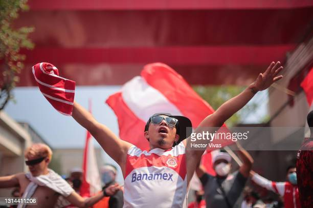 Fan of Toluca cheers before the 16th round match between Toluca and America as part of the Torneo Guard1anes 2021 Liga MX at Nemesio Diez Stadium on...