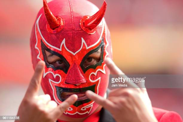 A fan of Toluca wearing a devil mask cheers for his team during the Final second leg match between Toluca and Santos Laguna as part of the Torneo...