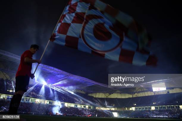 A fan of Trabzonspor waves a flag during the 50th foundation anniversary of Trabzonspor at the Senol Gunes Sport Complex in Trabzon Turkey on August...