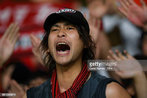Fan of Urawa Reds enjoys the atmosphere during the FIFA Club World Cup UAE 2017 fifth place playoff match between Wydad Casablanca and Urawa Reds on...