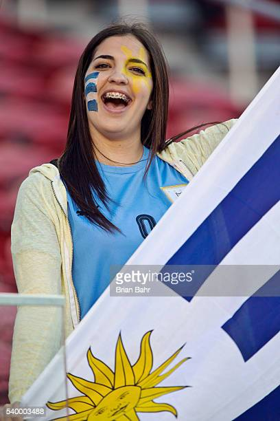 A fan of Uruguay waves a flag before a group C match between Uruguay and Jamaica at Levi's Stadium as part of Copa America Centenario US 2016 on June...
