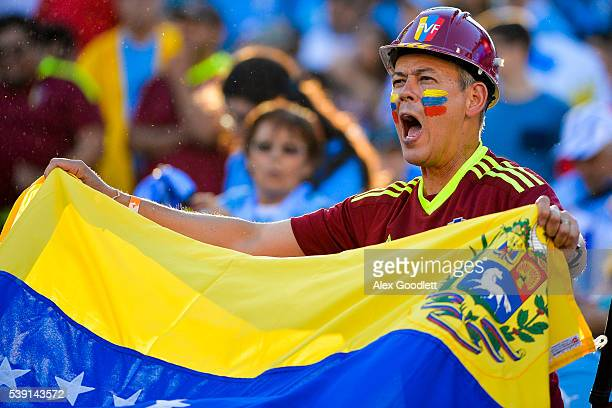 A fan of Venezuela cheers for his team before a group C match between Uruguay and Venezuela at Lincoln Financial Field as part of Copa America...