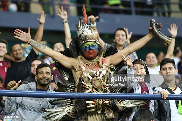 A fan of Venezuela cheers for his team before a match between Venezuela and Brazil as part of FIFA 2018 World Cup Qualifiers at Metropolitano Stadium...