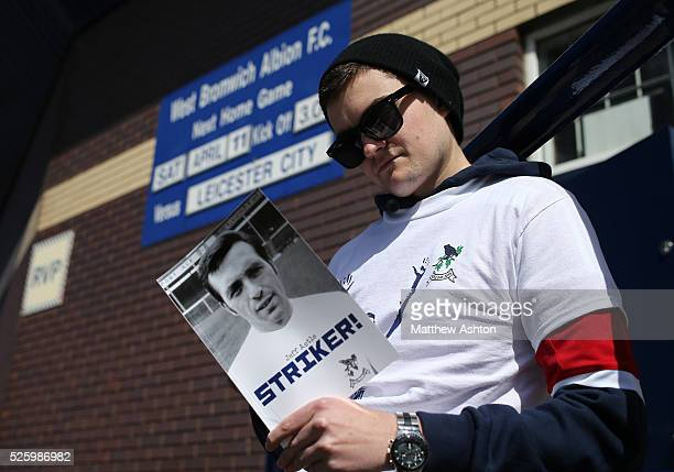 A fan of West Bromwich Albion reads the match day programme on Jeff Astle Day celebrating the former WBA legend who made his debut against Leicester...