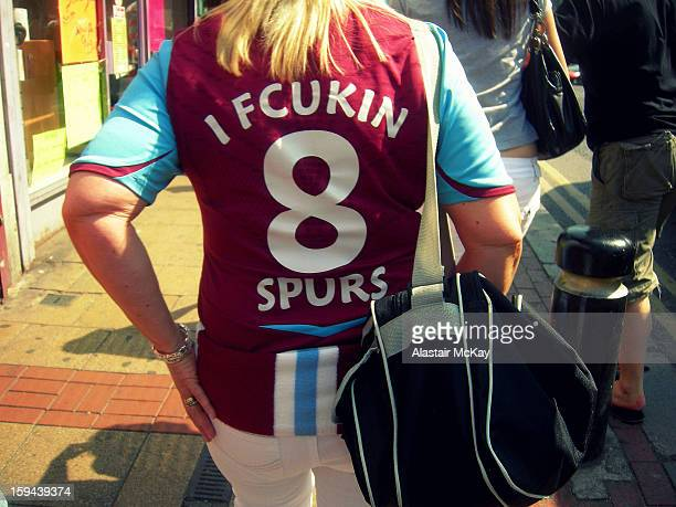 Fan of West Ham United football club displays the traditional rivalry with Tottenham Hotspur on her replica shirt. Picture taken on Green Street,...