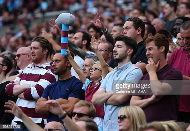 A fan of West Ham with a soft hammer toy during the Premier League match between West Ham United and AFC Bournemouth at Olympic Stadium on August 21...