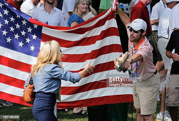 A fan offers a toy squirrel to Amy Mickelson of the US Team on the second hole during the Day Two Foursome Matches at the Muirfield Village Golf Club...