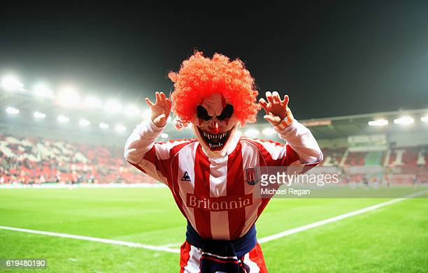A fan parades in a Halloween fancy dress costume prior to the Premier League match between Stoke City and Swansea City at Bet365 Stadium on October...