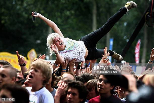 A fan participate in a crowd surfing during a concert on the first day of the Pukkelpop music festival 16 August 2007 at the Kiewit site in Hasselt...