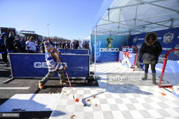 A fan participates in the GEICO pregame activities prior to the 2018 Bridgestone NHL Winter Classic at Citi Field on January 1 2018 in the Flushing...