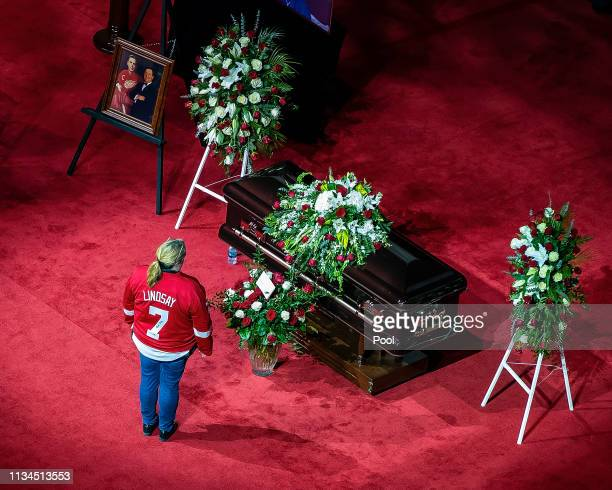 A fan pays her respects during the public visitation of NHL Hall of Famer and former Detroit Red Wing Ted Lindsay at Little Caesars Arena home of the...