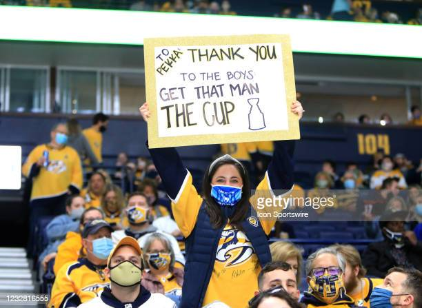 Fan pays tribute to Nashville Predators goalie Pekka Rinne , of Finland, during the NHL game between the Nashville Predators and Carolina Hurricanes,...
