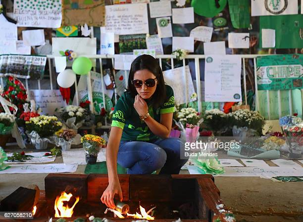 A fan pays tribute to the players of Brazilian team Chapecoense Real at the club's Arena Conda stadium in Chapeco in the southern Brazilian state of...