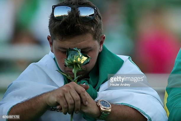 A fan pays tribute to the players of Brazilian team Chapecoense Real who were killed in a plane accident in the Colombian mountains at the club's...
