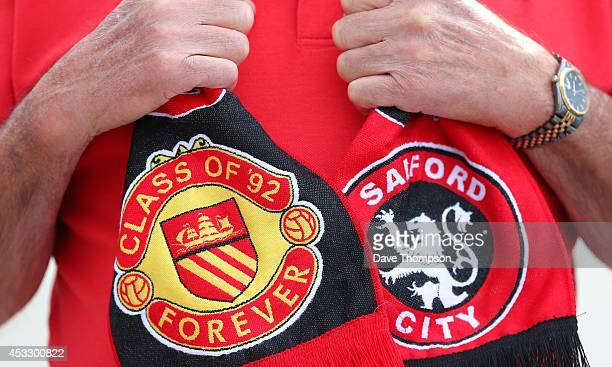 Fan Phil Douch from Somerset poses with a scarf before the match between Salford City and the Class of '92 XI at AJ Bell Stadium on August 7 2014 in...