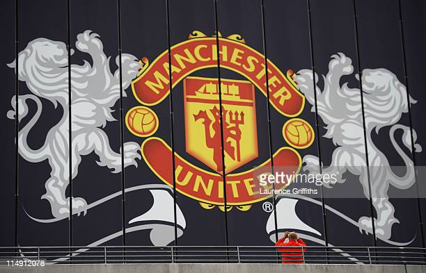 A fan photographs a Manchester United billboard ahead of the UEFA Champions League final between FC Barcelona and Manchester United FC at Wembley...