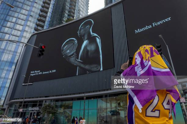 Fan photographs a mural memorializing former NBA star Kobe Bryant, who was killed in a helicopter crash in Calabasas, California, near the Staples...