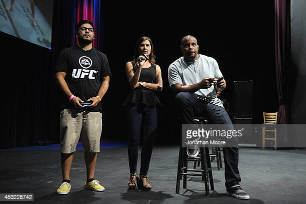 A fan plays a game of EA Sports' UFC against mixed martial artist Daniel Cormier after a UFC QA session at LA Live on August 5 2014 in Los Angeles...