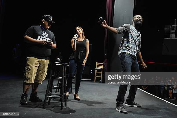 A fan plays a game of EA Sports' UFC against mixed martial artist Jon Jones after a UFC QA session at LA Live on August 5 2014 in Los Angeles...