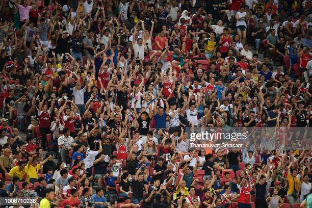Fan plays wave during the International Champions Cup match between Arsenal and Paris Saint Germain at the National Stadium on July 28 2018 in...
