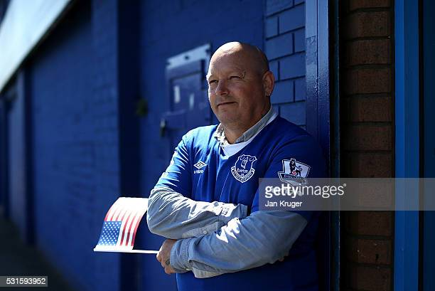 A fan poses ahead of the Barclays Premier League match between Everton and Norwich City at Goodison Park on May 15 2016 in Liverpool England