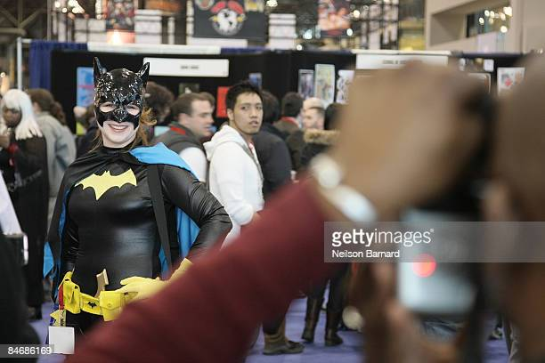 A fan poses as her favorite comic book and science fiction character 'Batgirl' at the 2009 New York Comic Con at the Jacob Javits Center on February...