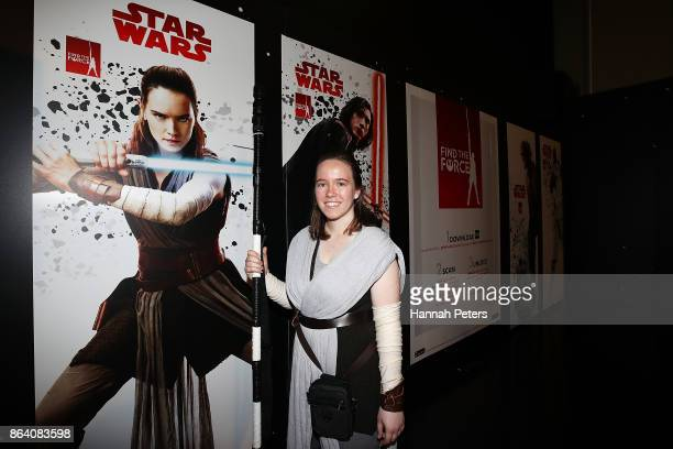 A fan poses at Star Wars The Last Jedi booth at Armageddon on October 21 2017 in Auckland New Zealand