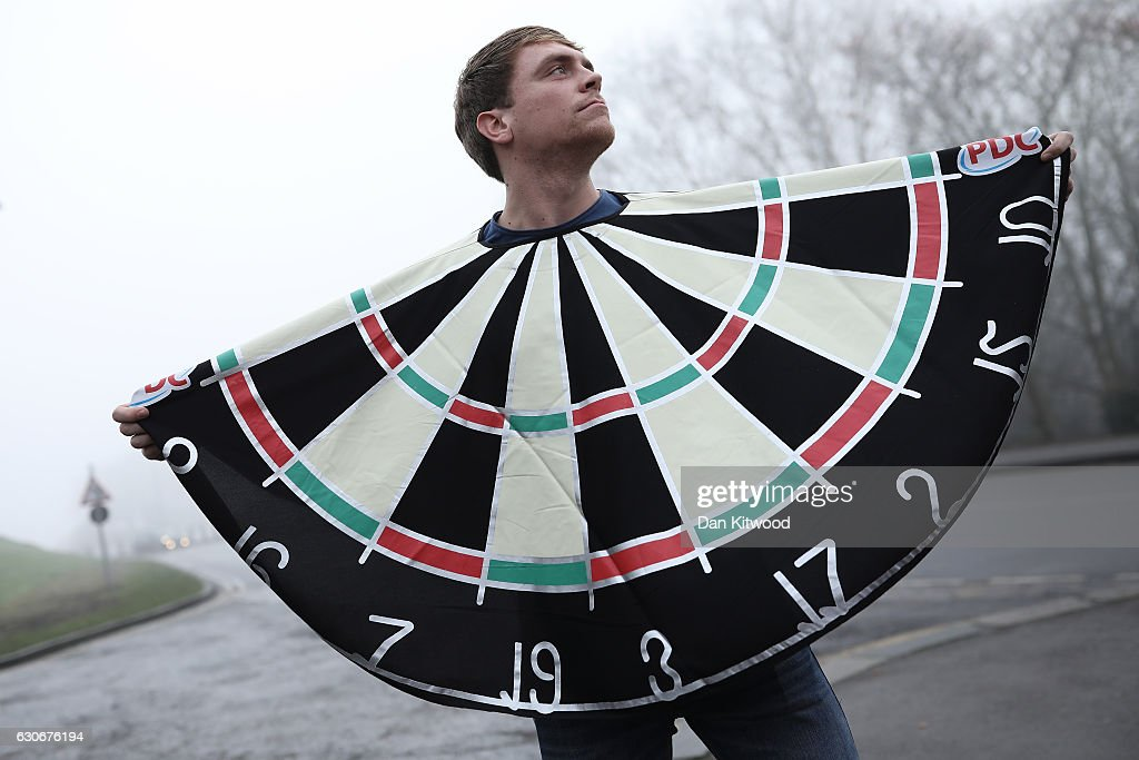 A fan poses dressed as a darts board outside Alexandra Palace ahead of the quarter finals of the 2016 William Hill World Darts Championship on December 30, 2016 in London, England. The event is the world's biggest darts tournament, with 72 players from across the globe competing across 15 days of the knock out competition.